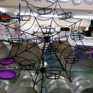 Spiderweb shaped cupcake stand .